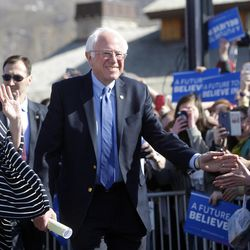 Democratic presidential candidate and Vermont Sen. Bernie Sanders, along with his wife, Jane, left, greets supporters before giving a speech at This is the Place Heritage Park in Salt Lake City, Friday, March 18, 2016.