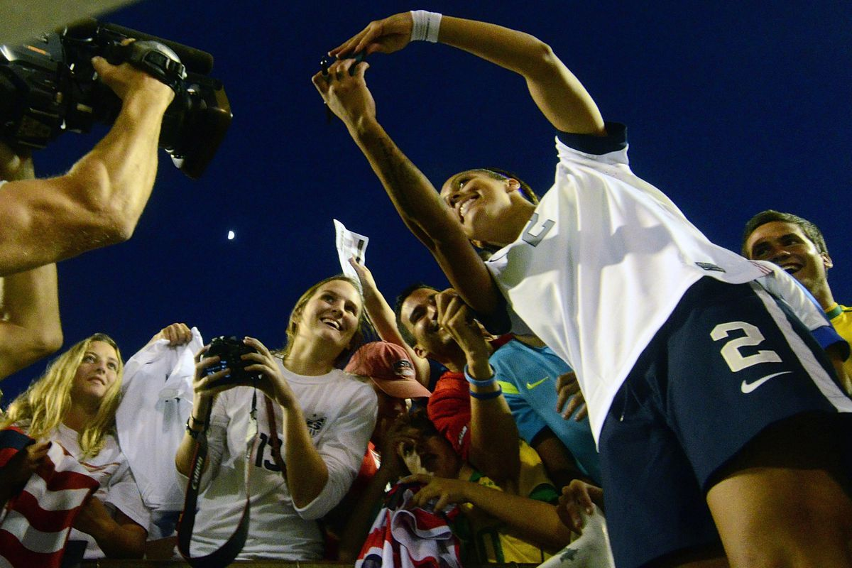 Breakers' forward Sydney Leroux takes  a fan photo after defeating Brazil