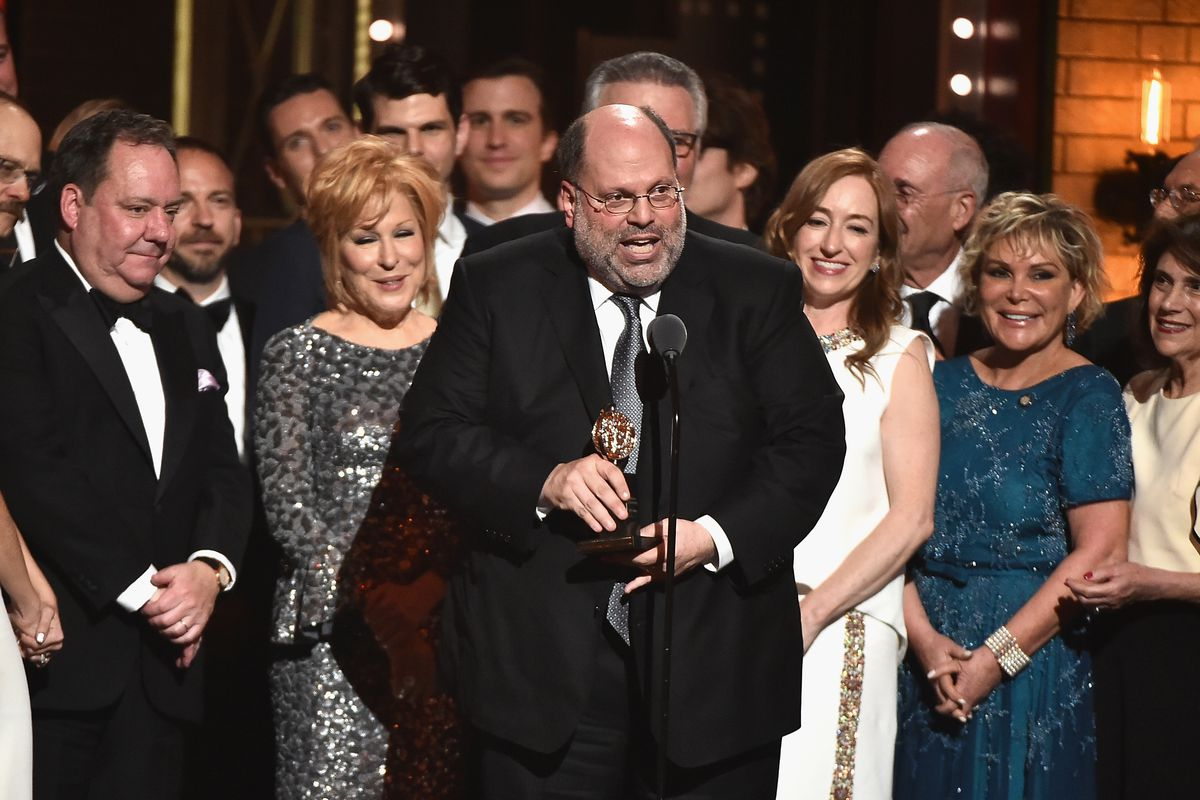 """Producer Scott Rudin (center) and the cast of Hello, Dolly!"""" (including Bette Midler, left) accept the award for best revival of a musical onstage during the 2017 Tony Awards at Radio City Music Hall in New York City."""