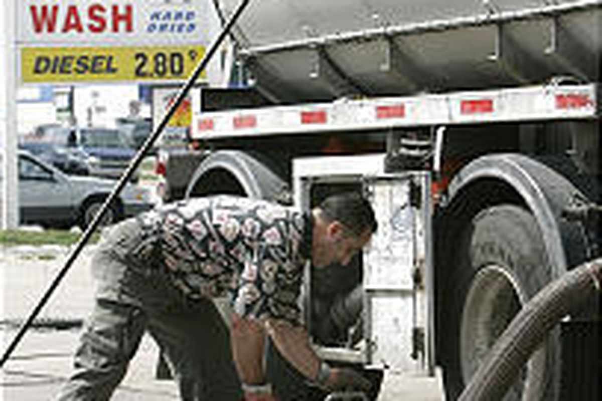 Ali Jalloul delivers unleaded fuel to a Marathon station in Detroit Wednesday.