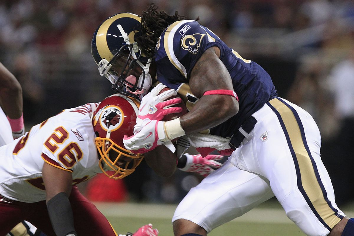 ST. LOUIS, MO - OCTOBER 2:   Steven Jackson #39 of the St. Louis Rams advances the ball against Josh Wilson #26 of the Washington Redskins October 2, 2011 at the Edward Jones Dome in St. Louis, Missouri. (Photo by Whitney Curtis/Getty Images)