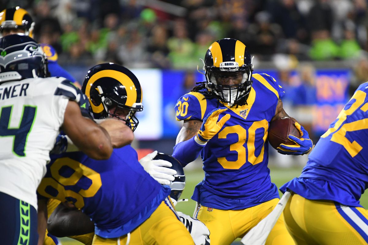 Los Angeles Rams running back Todd Gurley runs the ball against the Seattle Seahawks in the first half of a NFL game at Los Angeles Memorial Coliseum.