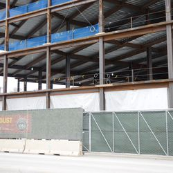12:51 p.m. View of the first level of the plaza building covered up, along Clark Street -