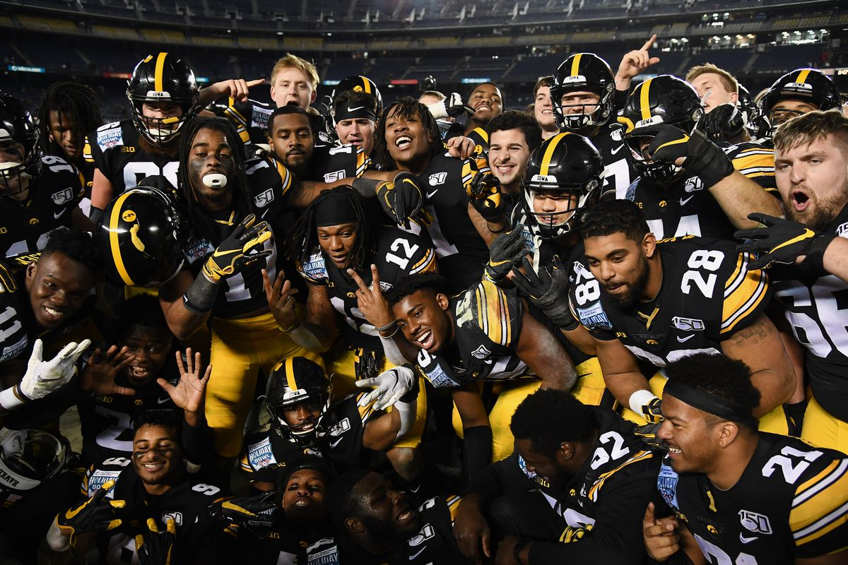 Iowa Hawkeyes players celebrate on the field after the Hawkeyes defeated the USC Trojans 49 to 24 in the Holiday Bowl played on December 27, 2019 at SDCCU Stadium in San Diego, CA.