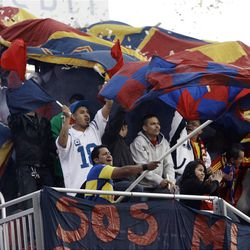 Real Salt Lake fans celebrate the first goal against the Colorado Rapids during their MLS match up at Rio Tinto Stadium in Sandy Saturday, April 7, 2012.
