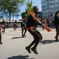 The Golden Knights Drill Team performs during the Bud Billiken Parade in the Bronzeville neighborhood Saturday.