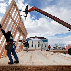 Crews from Dawson building systems put up a wall on a new home in Daybreak on Friday, Feb. 3, 2017. According to the 2017 Salt Lake Housing Forecast report released on Friday by the Salt Lake Board of Realtors, the Salt Lake County real estate market in 2016 had its best year in a decade.