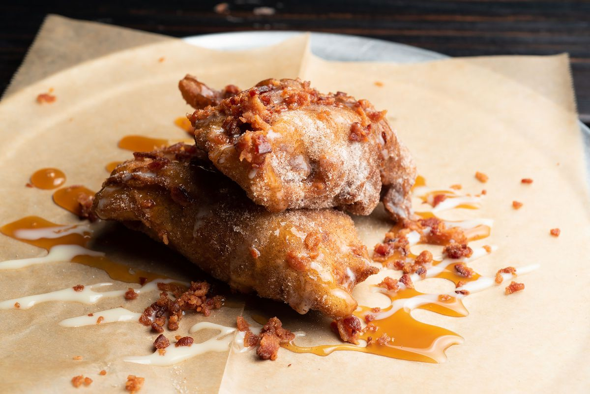 Hog Pocket, a sweet empanada filled with PB & J, rolled in churro sugar and topped with bacon bits