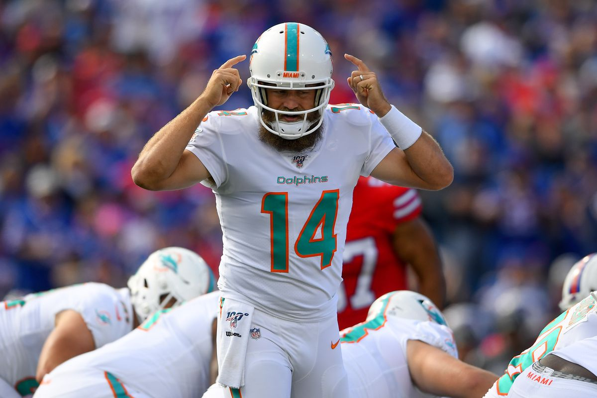 Miami Dolphins quarterback Ryan Fitzpatrick calls a play at the line against the Buffalo Bills during the first quarter at New Era Field.
