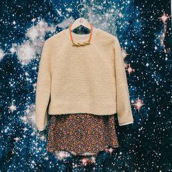 "Nanushka 'Minnet' sweater, $250; Clothes 'Caroline' skirt, <a href=""http://americantwoshot.com/women/skirts/clothes-caroline-cord-skirt"">$165</a>; Orly Genger necklace, $260"