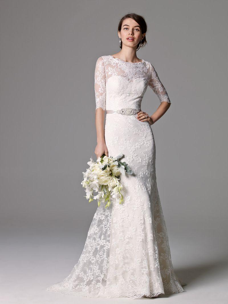 A Model Wearing Lace Wedding Dress