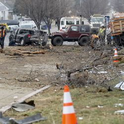 Emergency responders work at the scene of a collision involving eight vehicles spanning the block between 300 East and 400 East on 400 North in Bountiful on Thursday, Dec. 10, 2020. A dump truck hit a power pole and seven vehicles, some vacant and parked, leaving four people injured.
