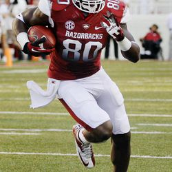 Arkansas tight end Chris Gragg carries during the first quarter of an NCAA college football game against Jacksonville State in Fayetteville, Ark., Saturday, Sept. 1, 2012.