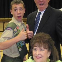 Britain Covey poses with his grandpa, Stephen R. Covey, and his grandma, Sandra, at a Boys Scouts function.