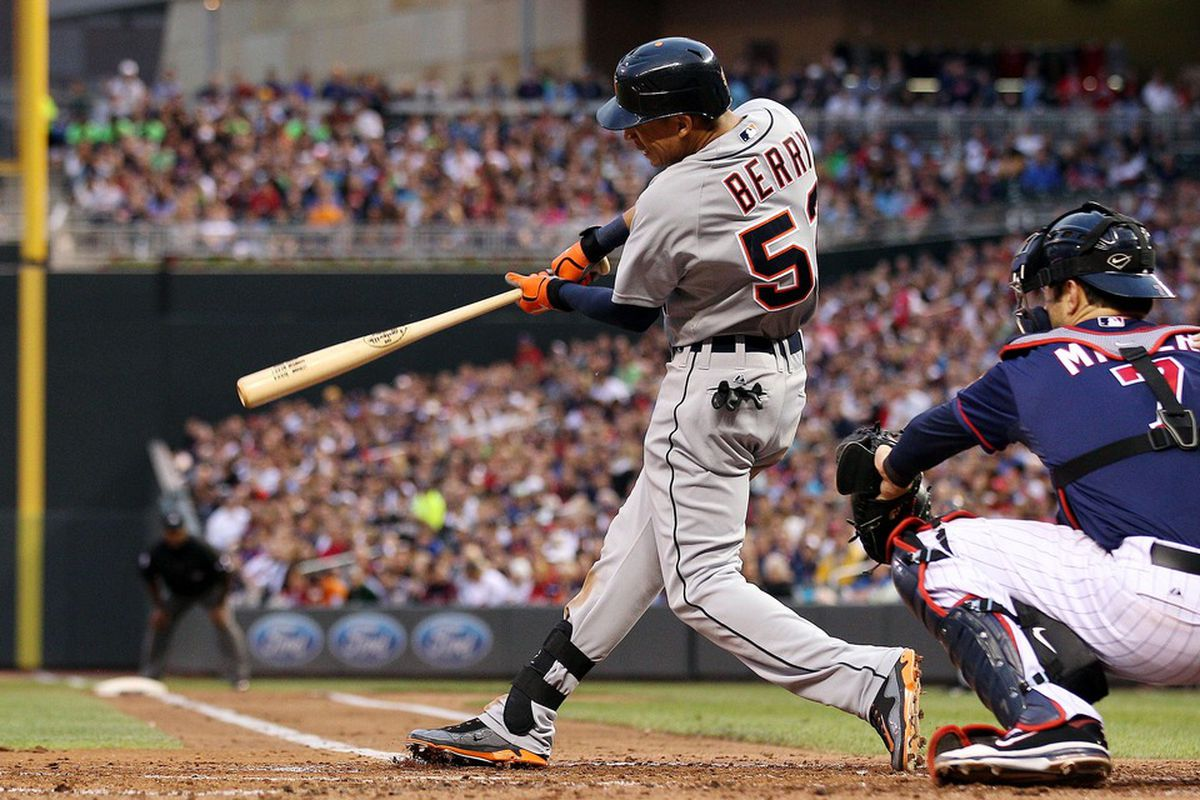 May 25, 2012; Minneapolis, MN, USA: Detroit Tigers center fielder Quintin Berry (52) hits an RBI single in the second inning against the Minnesota Twins at Target Field. Mandatory Credit: Jesse Johnson-US PRESSWIRE