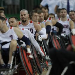 United States' Josh Wheeler, center left, rides his wheelchair in line with his teammates at the end of the mixed wheelchair rugby final match against Australia at the Paralympic Games in Rio de Janeiro, Brazil, Sunday, Sept. 18, 2016. Australia won the gold medal.