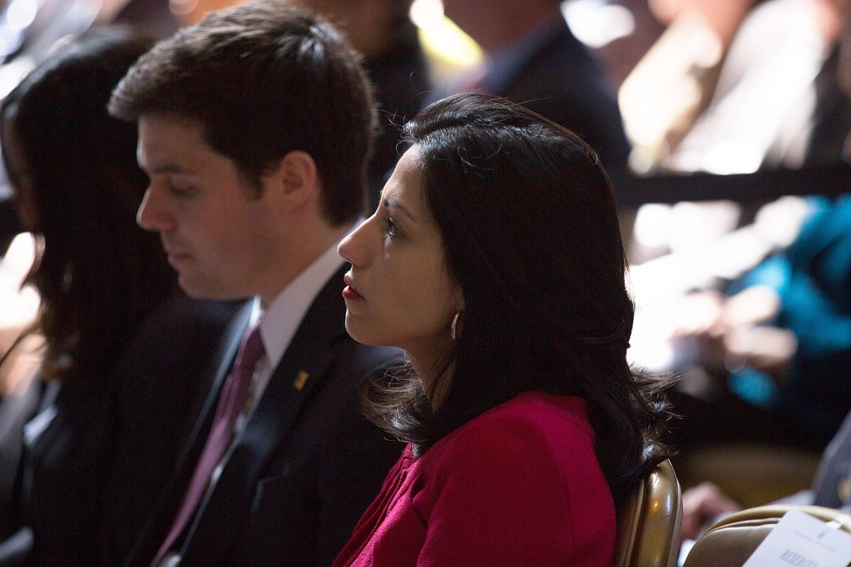 Clinton aides Huma Abedin (right) and Nick Merrill watched as the former secretary of State spoke during the David N. Dinkins Leadership and Public Policy Forum at Columbia University April 29, 2015 in New York City.