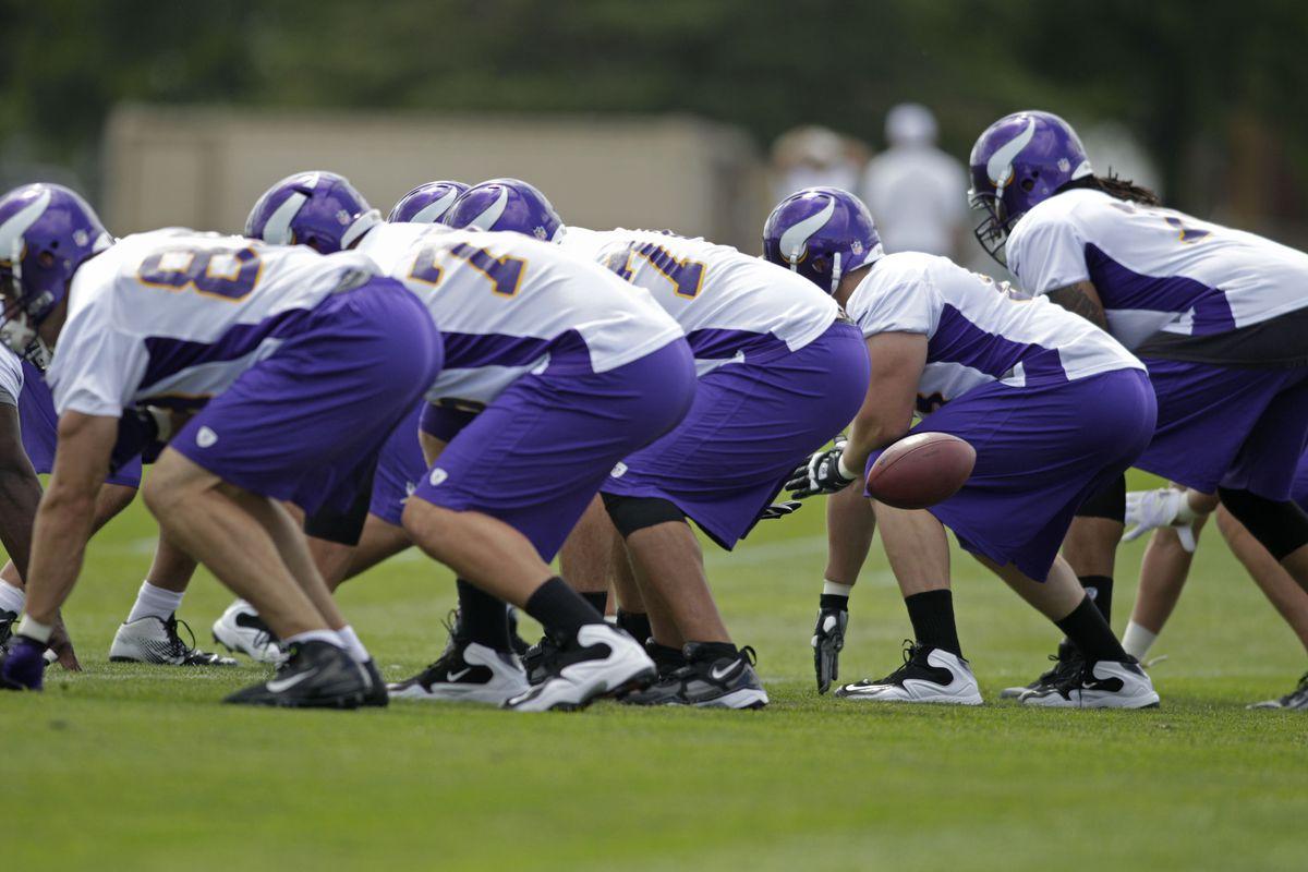 Jul 27, 2012; Mankato, MN, USA; Minnesota Vikings offensive line run drills at training camp at Blakeslee Stadium at Minnesota State University, Mankato. Mandatory Credit: Bruce Kluckhohn-US PRESSWIRE