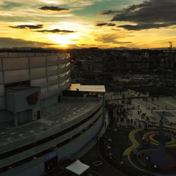 The sun sets as attendees leave a devotional at Movistar Arena in Bogota, Colombia, on Sunday, Aug. 25, 2019.