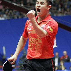 FILE - In this April 1, 2012 file photo, China's Wang Hao reacts after winning the final of the World Team Table Tennis championships between China and Germany, in Dortmund, Germany. China owns table tennis like the United States once dominated men's basketball. It has won every gold medal in three Olympics, and four years ago in Beijing it finished 1-2-3 in both men's and women's singles, and swept gold in both team events.