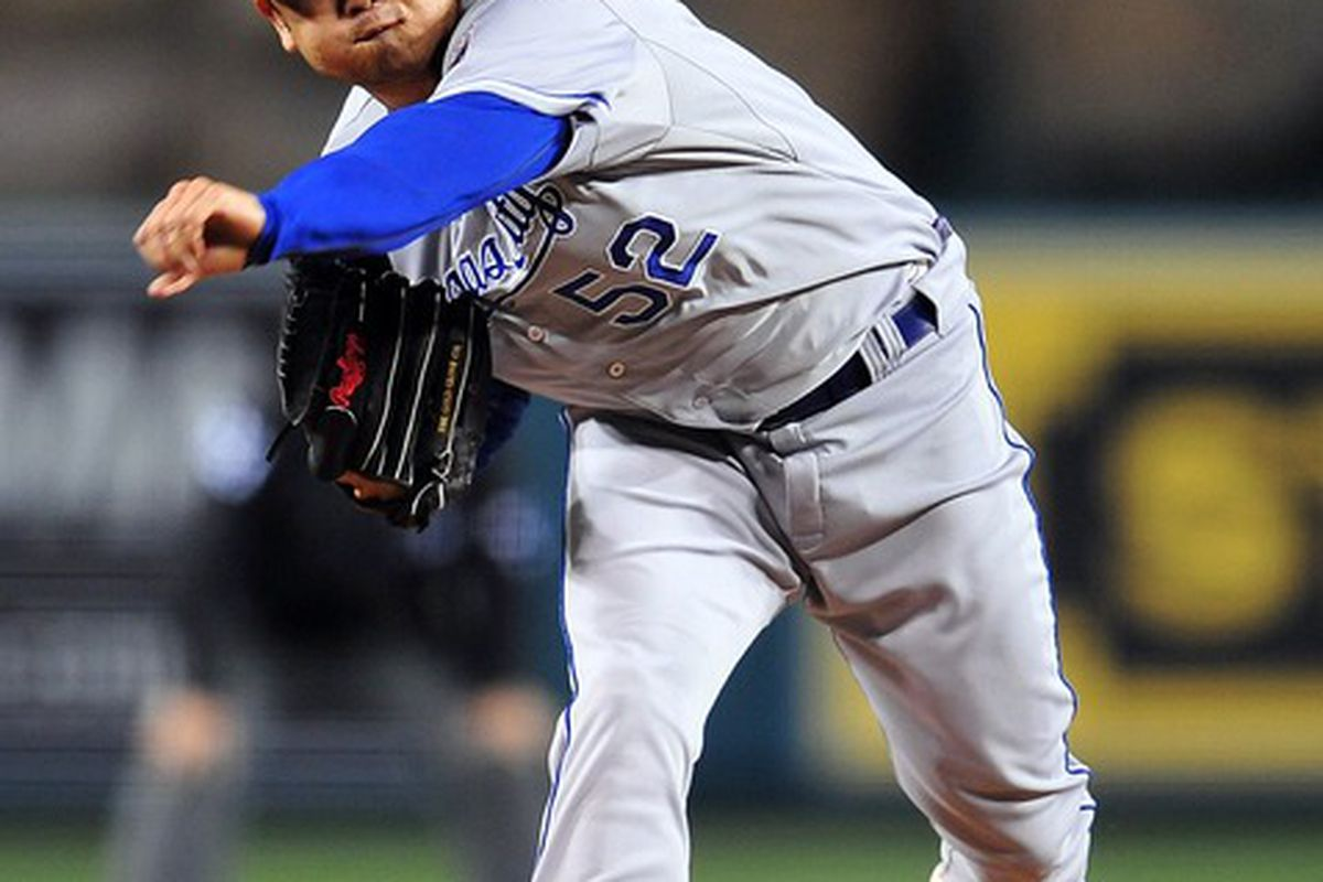April 6, 2012; Anaheim, CA, USA; Kansas City Royals starting pitcher Bruce Chen (52) pitches in the second inning against the Los Angeles Angels at Angel Stadium. Mandatory Credit: Gary A. Vasquez-US PRESSWIRE