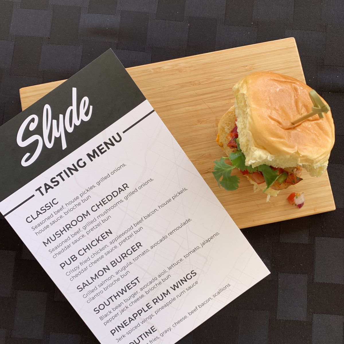 A slider on a wooden board next to a Slyde menu.