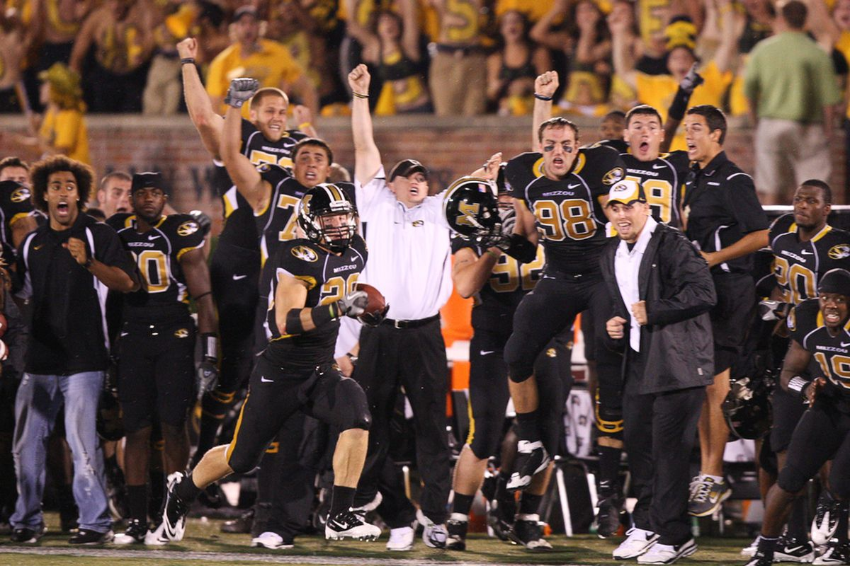 """Receiver T.J. Moe runs down the sideline for the game-winning touchdown in the final minute of Missouri's 27-24 win against San Diego State at Faurot Field. (Photo by Bill Carter 