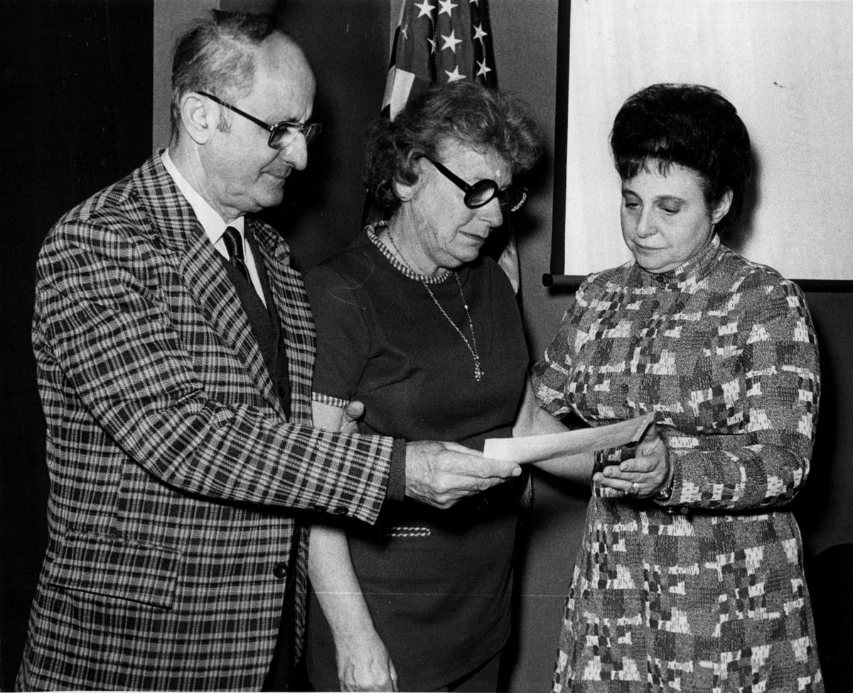 In 1973, Mr. and Mrs. Herman Lucas present a check for $700 to the Niles Township High School Board in honor of their son, Larry, who was killed in a fire in the Sear Tower.