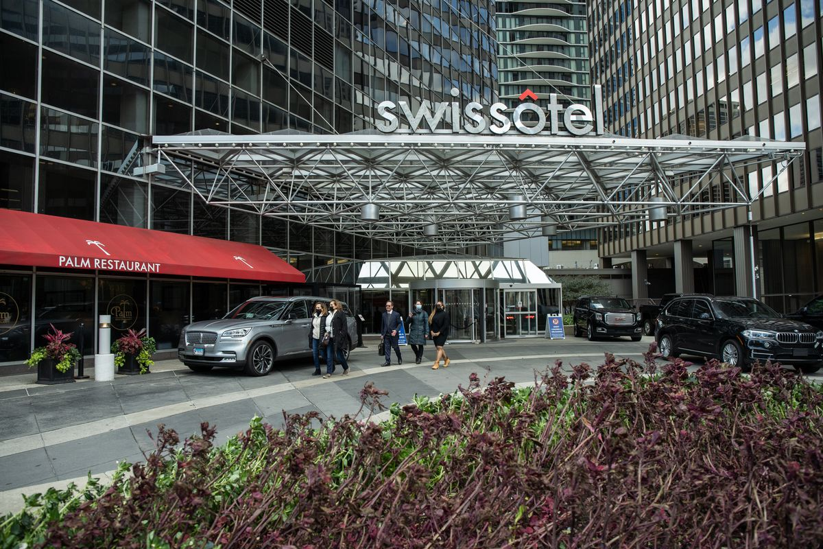 Terminated Swissotel employees Maria Teresa Hernandez, Maria Ruiz and Maria Lourdie Pierre-Jacques walk out of Swissotel, 323 E. Wacker Dr., with their attorney, Stephen Yokich, on Tuesday, Oct. 26, 2021 after delivering a copy of the lawsuit they filed against the hotel.