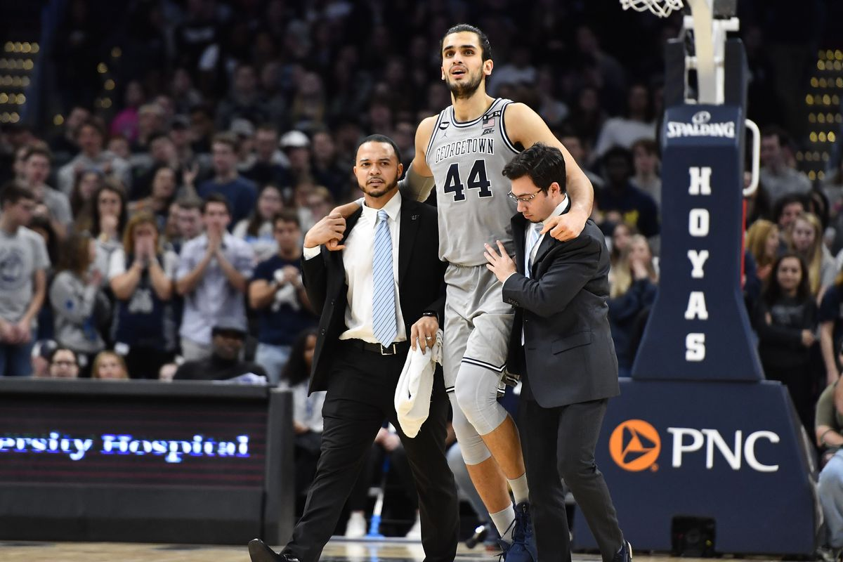 Georgetown Hoyas center Omer Yurtseven leaves the game after suffering an apparent ankle injury against the DePaul Blue Demons during the second half at Capital One Arena