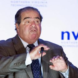 Supreme Court Justice Antonin Scalia makes gestures as he speaks at the Northern Virginia Technology Council's (NVTC) Titans breakfast gathering in McLean, Va., Wednesday, Sept. 25, 2013. Scalia was the featured speaker at the speaker series sponsored by the Council. The 77-year-old justice, currently the longest serving on the nine-member court, is scheduled to discuss the art of persuasion as well as major constitutional issues.