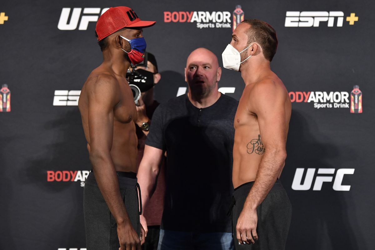 In this handout image provided by UFC, Opponents Neil Magny and Anthony Rocco Martin face off during the UFC 250 weigh-in at UFC APEX on June 05, 2020 in Las Vegas, Nevada.