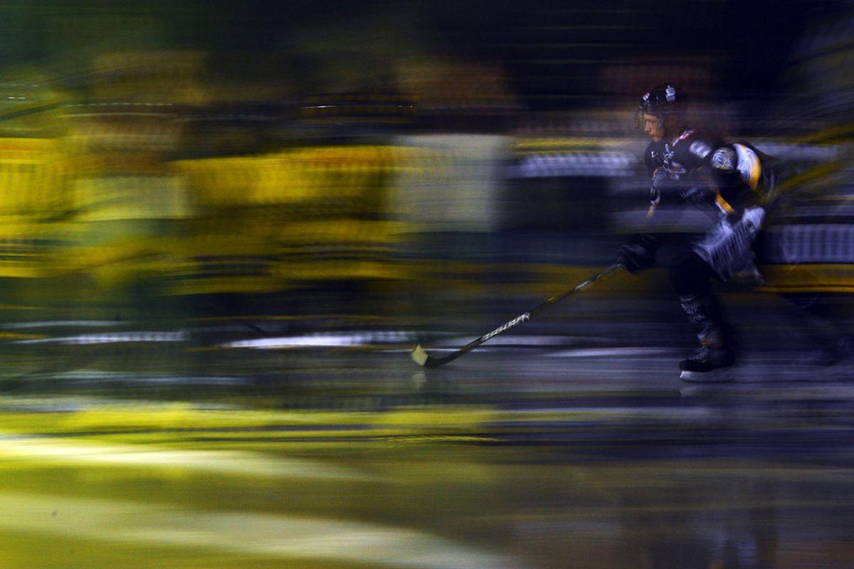 KREFELD, GERMANY - DECEMBER 30: Sinan Akdag of Krefeld attends the ice during the DEL match between Krefeld Pinguins and Eisbaeren Berlin at the Koenigspalast on December 30, 2011 in Krefeld, Germany.  (Photo by Lars Baron/Bongarts/Getty Images)