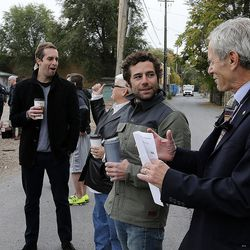 Mayor Ralph Becker, right, talks with Chris Talvy before a groundbreaking for the new Central Ninth Market in Salt Lake City, Wednesday, Oct. 28, 2015. The 9,216-square-foot commercial building will be occupied by six locally-owned small businesses, including Jade Market, which will stand as the first local food market in the neighborhood.