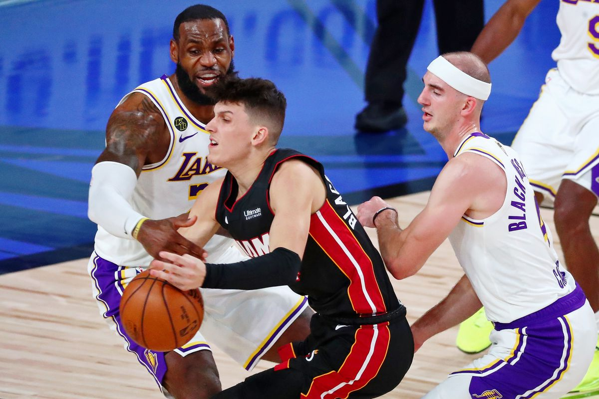 Los Angeles Lakers forward LeBron James fouls Miami Heat guard Tyler Herro during the second quarter of game three of the 2020 NBA Finals at AdventHealth Arena.