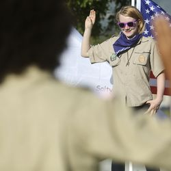 """Amie """"Nico"""" Nickell makes the Scout sign during a Boy Scout meeting for the all-female Troop 314 at Parkview Park in Stansbury Park on Monday, July 6, 2020."""