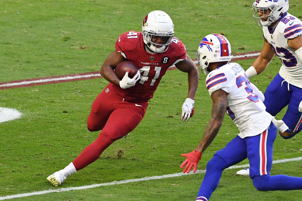 Running back Kenyan Drake #41 of the Arizona Cardinals runs the ball as cornerback Dane Jackson #30 and safety Micah Hyde #23 of the Buffalo Bills defend during the first half at State Farm Stadium on November 15, 2020 in Glendale, Arizona.