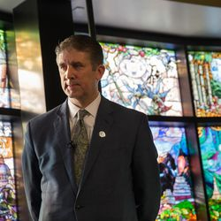 """Utah Valley University President Matthew S. Holland is pictured during the unveiling of the """"Roots of Knowledge"""" stained glass window display at the UVU library on Friday, Nov. 18, 2016, in Orem."""