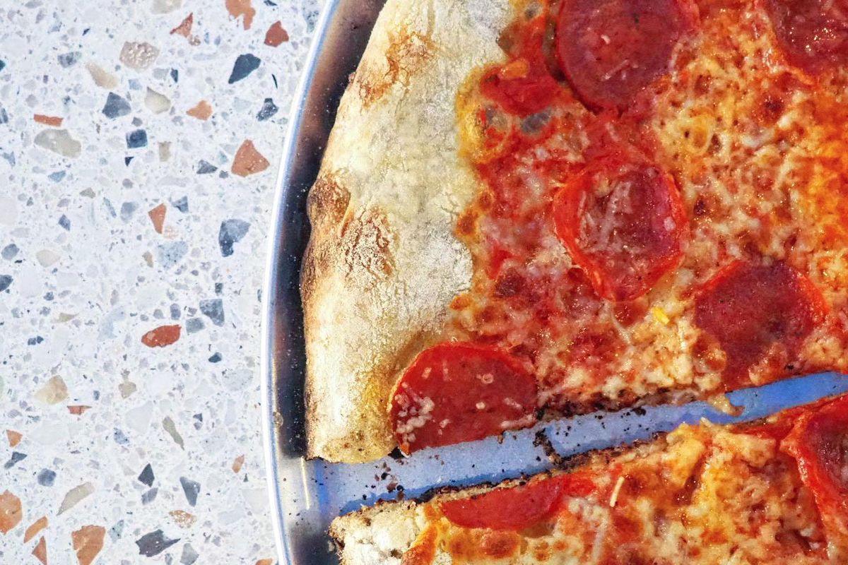 pizza on terrazzo counter