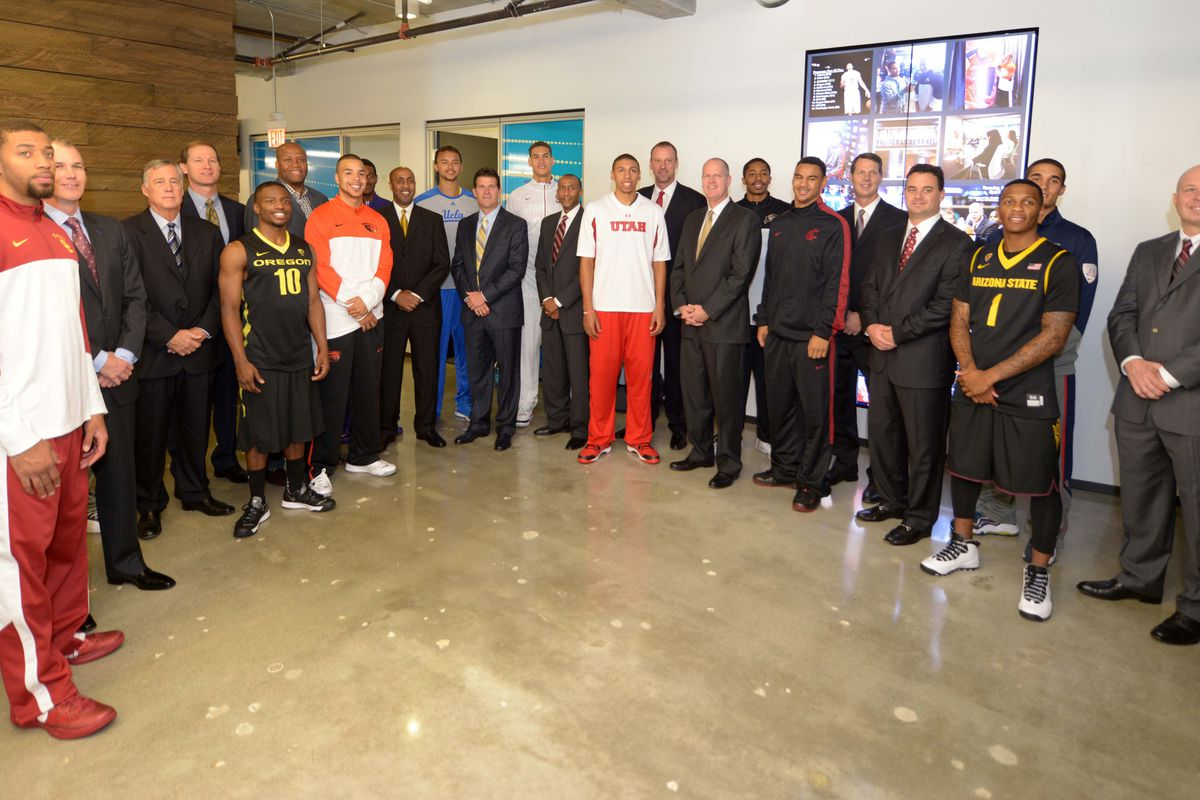 Pac-12 players and coaches pose during Pac-12 media day in San Francisco