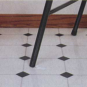 <p>A snagged chair leg floor ripped open this section of sheet-vinyl flooring. The remedy is to install a replacement patch.</p>