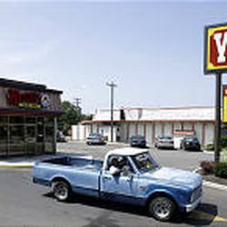 A truck departs a Wendy's in Whitehall, Ohio, that has no sit-down service. Chains are developing restaurants with smaller kitchens, eating areas.