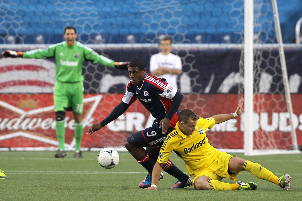 FOXBORO, MA - JUNE 16:  Jose Moreno #9 of the New England Revolution battles Josh Williams #3 of the Columbus Crew in the second half during a game at Gillette Stadium on June 16, 2012 in Foxboro, Massachusetts. (Photo by Jim Rogash/Getty Images)