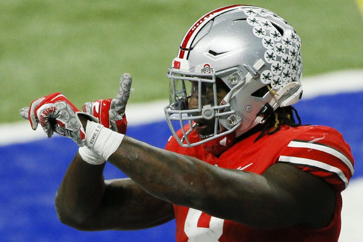 Ohio State Buckeyes running back Trey Sermon (8) celebrates after scoring a touchdown during the third quarter of the Big Ten Championship football game between the Ohio State Buckeyes and the Northwestern Wildcats on Saturday, Dec. 19, 2020 at Lucas Oil Stadium in Indianapolis. Cfb Big Ten Championship.