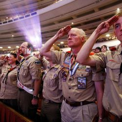 Scouters stand and salute during the national anthem. Thousands of scouts and their leaders assemble Tuesday, Oct. 29, 2013 in the Conference Center in Salt Lake City to celebrate a century of honor.