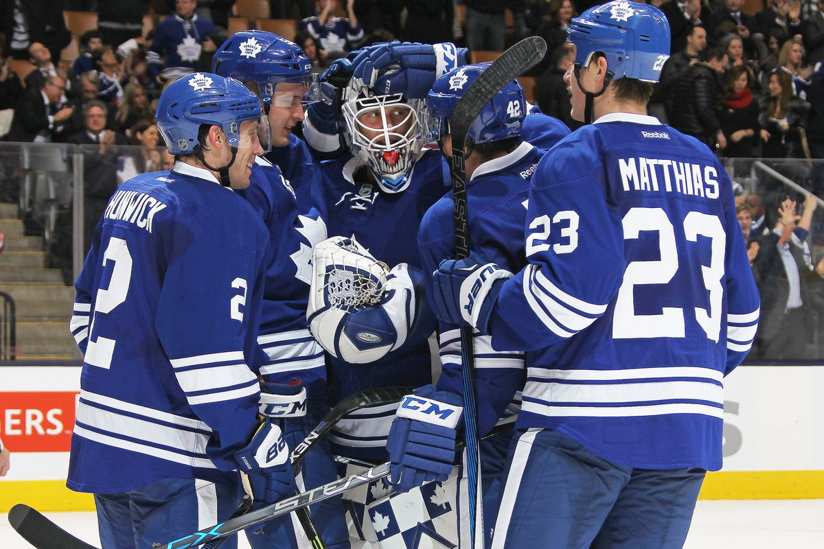 TORONTO, ON - NOVEMBER 30: Garret Sparks #31 of the Toronto Maple Leafs is congratulated by his teammates after earning a shut-out in his 1st NHL game against the Edmonton Oilers in an NHL game at Air Canada Centre on November 30, 2015 in Toronto, On