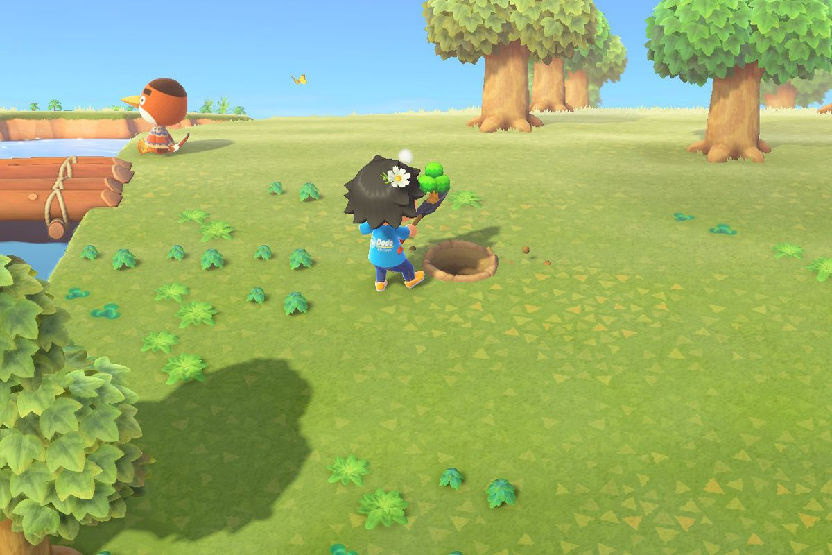 A villager uproots a tree in Animal Crossing: New Horizons