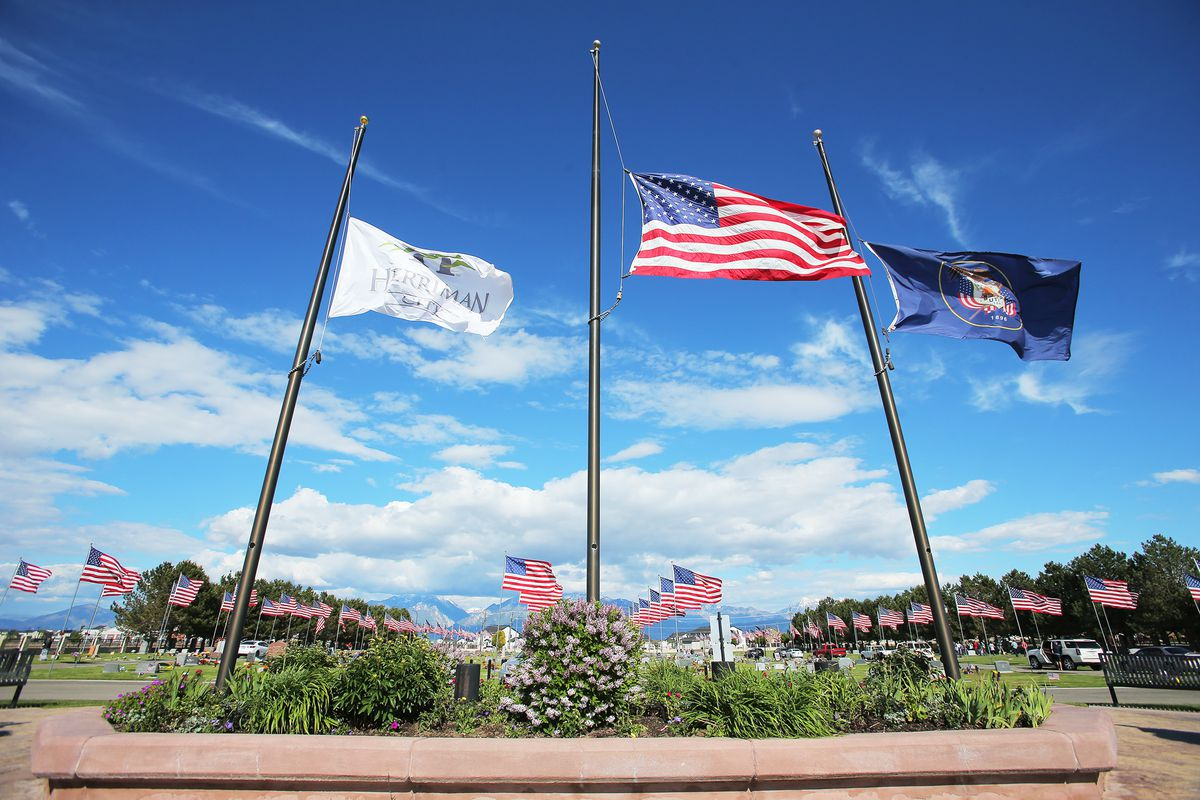 The main flags at the Herriman City cemetery fly at half-staff in recognition of those that have lost their lives to COVID-19, along with flags honoring veterans on Sunday, May 24, 2020. Gov. Gary Herbert issued an order to lower flags on all state and public grounds in honor of victims of the COVID-19 pandemic and others were encouraged to join the tribute.