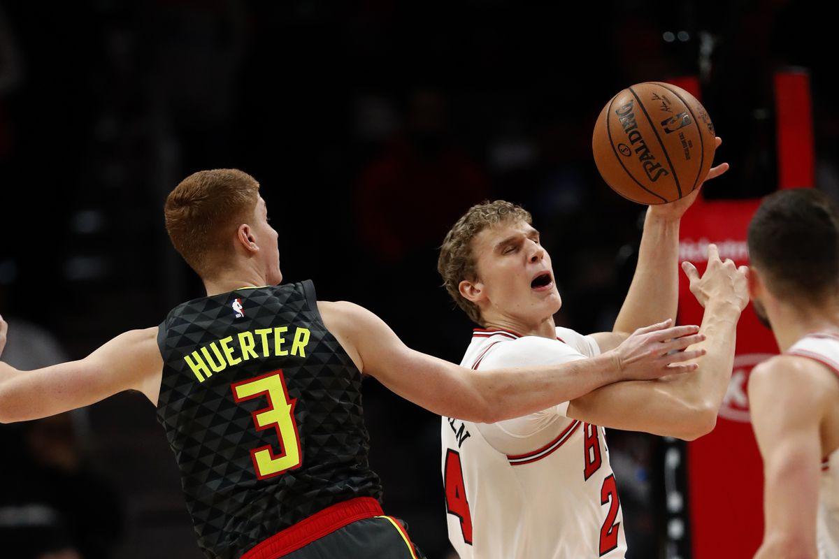 Chicago Bulls forward Lauri Markkanen goes up for a shot as Atlanta Hawks guard Kevin Huerter defends Wednesday, Nov. 6, 2019, in Atlanta.