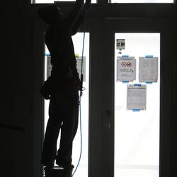 A construction worker labors on a new unit at Garbett Homes in South Jordan on Tuesday, March 12, 2013.